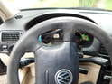 The airbag is removed by accessing two release catches on the backside of the steering wheel.