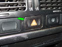 Use a small pick to carefully pry the flasher switch (green arrow) out of the dashboard.