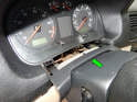 Here is the trim piece pulled back off the dash (green arrow).