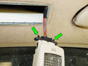 Once the dome light is removed, squeeze the two release tabs (green arrows) on the electrical connector and pull it out of the dome light.