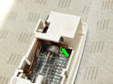 When fitting the new bulb, angle it into place on the inner electrical connector as shown here (green arrow).