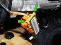 Now press the two yellow fingers (green arrows) and pull the connection apart.