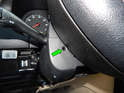 Now rotate the steering wheel the opposite direction until you can access the other screw hole (green arrow).