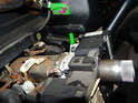 Locate the T20 Torx screw clamping the switch to the steering column.