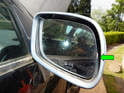 Begin by moving the mirror glass all the way over to one side (green arrow).