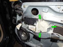 The front power window motor is accessed by removing the door panel.