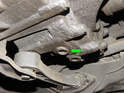 Shown here is the drain plug (green arrow) located at the rear of the transmission near the rear mount.