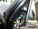 Loosen and remove the T45 Torx bolt (green arrow).