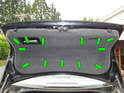 Loosen and remove the 13 Phillips head screws (green arrows) holding the trunk liner to the trunk lid.