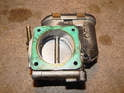 Be sure to remove the old gasket from the throttle body.