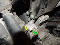 This picture with the alternator removed shows the tensioner in better detail.
