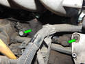 Use a 13mm socket to loosen and remove the 13mm bolts (green arrows) holding both sensors to the engine block.