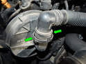 Squeeze the tabs (green arrows) on the larger secondary air hose and pull it off the secondary air pump.