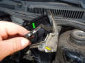 Pull the old gasket (green arrow) out of the channel (yellow arrow) on the valve cover.