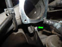 Shown here is the 6mm hex mounting bolt (green arrow) on the left ride side of the manifold.