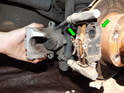 Left and Right Sides - Now slide the brake pads (green arrows) off the caliper-mounting frame.