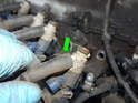 Pull the vacuum hose off the fuel injector.