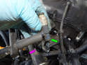 Now pull the injector (green arrow) out of the fuel rail (purple arrow).