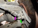 Front Sensor, Left and Right Sides: Shown here is the front ABS sensor (green arrow) on the Mk4 Jetta.
