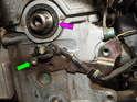Now remove the 6mm hex bolt (green arrow) and remove the cam position sensor assembly from the cylinder head.