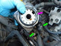 Now use a pair of hose clamp pliers to loosen and slide back the clamps on the coolant lines.