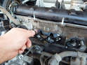 Remove the old manifold gasket from the mounting studs.