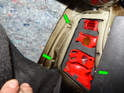 Loosen and remove the three 8mm nuts (green arrows) holding the taillight lens to the body.
