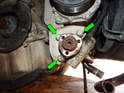 Now loosen and remove the three 13mm bolts (green arrows) securing the pump to the bracket.