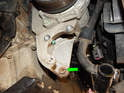 Note the metal collar (green arrow) in the pump bracket.