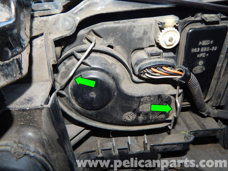 Left And Right Headlights Use A Driver To Pry Back The Retaining Clips Green
