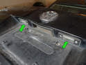 Shown here are the two license plate bulb holders (green arrows) on the Mk4 Jetta.
