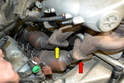 Check your hardware and remove the three nuts holding the bank 1-3 (red arrow) and 4-6 (yellow arrow) exhaust manifold to cat pipe.