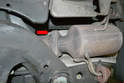 Depending on the type of tools you own you will want to remove the three exhaust nuts from above or below (red arrow).