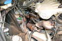 To remove them, first push the pipe down of the exhaust manifold.