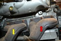 You now have access to the two exhaust manifolds; the forward one for banks 1-3 (red arrow) and the rear for banks 4-6 (yellow arrow).
