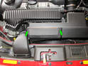 Open the hood and locate the filter housing at the front of the engine.