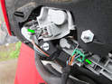 20:Both sides of car: Press the tabs on each electrical connector (green arrows) and pull them out of the circuit boards on the rear of the taillight assembly.