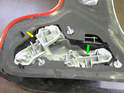 Both sides of car: Set the taillight assembly down and remove the rear fog/parking light board (yellow arrow) and the turn signal/reverse/parking light board (green arrow) from the light assembly.