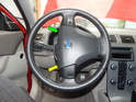 Turn the wheel 90 degrees from center so you can access the rear of the steering wheel.
