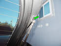 Use a screwdriver to pop the end of the shock (green arrow) off the ball pivot on the rear hatch.