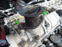 Loosen and remove the two 8mm bolts (green arrows) holding the oil filler cap on the camshaft cover.