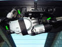Loosen and remove the three 10mm nuts holding the wiper motor to the rear hatch.