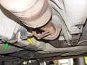 Move underneath the center of the car to the rear of the catalytic converter.