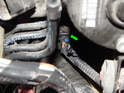 Clutch Master Cylinder: Press the tab on the electrical connector leading to the CMC and pull it off (green arrow).