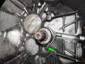 Clutch Slave Cylinder: Now loosen and remove the 8mm bolt (green arrow) holding the SC to the transmission.