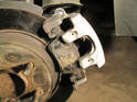 Left and Right Sides - Once they have been removed carefully lift the caliper up and off the lower frame and remove the old brake pads.