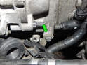 Remove the 10mm bolt (green arrow) holding the ground strap to the engine (green arrow), just to the left of the slave cylinder.
