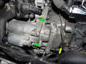 Loosen and remove the two, long 13mm nuts holding the starter motor to the transmission bellhousing.