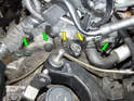 Loosen and remove the two T40 Torx bolts (yellow arrows) holding the mount for the crankshaft position sensor to the engine.