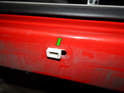 If one of the clips gets stuck in the chassis, pry it out and re-fit it to the trim piece if it is not damaged.